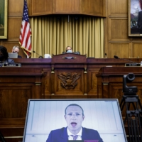 Facebook CEO Mark Zuckerberg testifies via videoconference during a hearing of the House Judiciary Subcommittee on antitrust in Washington in July.  | GRAEME JENNINGS / POOL / VIA THE NEW YORK TIMES