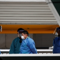 Personnel aboard the Quantum of the Seas on Wednesday  | REUTERS