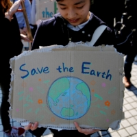 Tokyo students take part in a global strike for action on climate change in March 2019.  | REUTERS