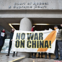 A small group of protesters gathers outside the B.C. Supreme Court while Huawei chief financial officer Meng Wanzhou attends a hearing in Vancouver on Monday.  | THE CANADIAN PRESS / VIA AP