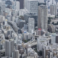 Business sentiment among large Japanese companies in the October-December period rose for the second straight quarter. | BLOOMBERG