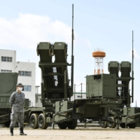 The Air Self-Defense Force conducts a drill to deploy Patriot Advanced Capability-3 ballistic missile interceptors in Itami, Hyogo Prefecture, on March 5, three days after North Korea launched two projectiles. | KYODO
