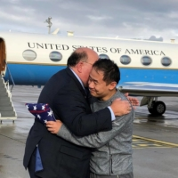 U.S. Ambassador to Switzerland Edward McMullen greets Xiyue Wang in Zurich after his release by Iran in December 2019. | U.S. EMBASSY IN SWITZERLAND / VIA REUTERS