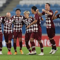 Vissel Kobe players celebrate after winning their AFC Champions League quarterfinal against Suwon Samsung Bluewings on Thursday at the Al Janoub Stadium in the Qatari city of Al Wakrah. | KYODO