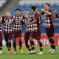 Vissel players celebrate after winning their Asian Champions League quarterfinal against Suwon on Thursday at Al Janoub Stadium in the Qatari city of Al Wakrah. | AFP-JIJI