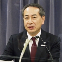 JTB Corp. President Eijiro Yamakita speaks at a news conference in November. The firm plans to reduce its group workforce by 6,500 by fiscal 2021. | KYODO