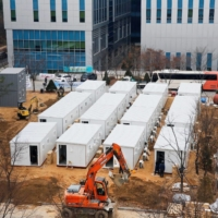 Workers make a temporary hospital ward outside the Seoul Medical Center on Thursday.  | REUTERS