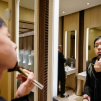 University student Liu Yuxuan, 22, typically uses Clinique and Estee Lauder but would consider domestic brands that offer value for money.  | REUTERS