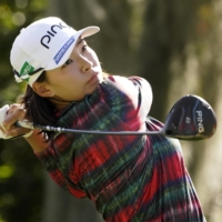 Hinako Shibuno hits off the third tee during the first round of the U.S. Women's Open in Houston on Thursday. | AP