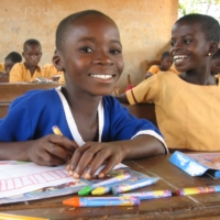 Ghanaian children attending school. ACE collaborates with a local NGO to protect the rights of children and provide access to education. | ACE