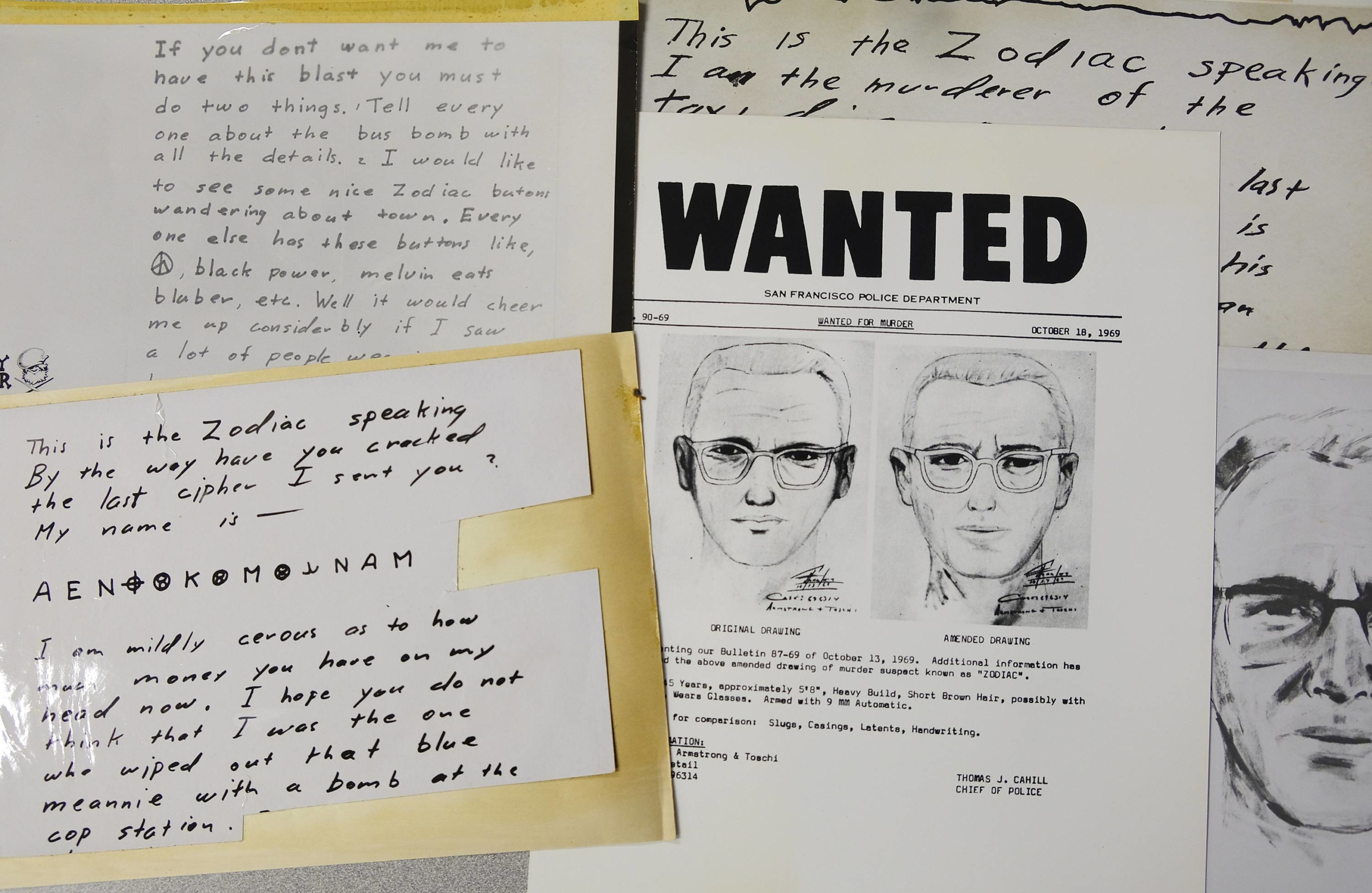 A San Francisco Police Department wanted bulletin and copies of letters sent to the San Francisco Chronicle by a man who called himself Zodiac are displayed in San Francisco. | AP