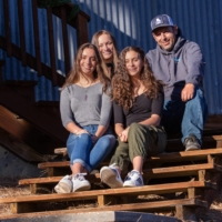 ENRIQUE LOPEZ, WHO IS TRYING TO PERSUADE HIS SKEPTICAL SNOW-REMOVAL BUSINESS EMPLOYEES THAT THE VACCINE IS SAFE, WITH HIS FAMILY AT HOME IN TRUCKEE, CALIF., DEC. 10, 2020. LOPEZ HAS SEEN HALF HIS WORK FORCE STRICKEN WITH THE VIRUS. 'IT'S A RISK WE HAVE TO TAKE. IT'S GOING TO MAKE US SAFER AND GO BACK TO NORMAL.' (CONSTANTINE PAPANICOLAOU/THE NEW YORK TIMES)