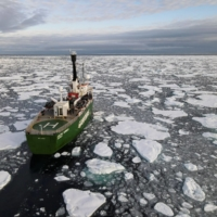 A ship navigates through floating ice in the Arctic Ocean in September.  | REUTERS