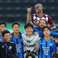 Ulsan Hyundai FC players celebrate after their ACL semifinal win against Vissel Kobe on Sunday in Doha. | REUTERS