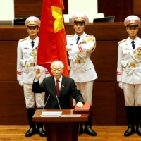 Vietnam's Communist Party General Secretary Nguyen Phu Trong takes his oath of office after being elected as Vietnam's state president during a National Assembly session in Hanoi on Oct. 23, 2018. | REUTERS