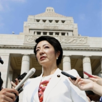Anri Kawai, an Upper House member, speaks to reporters at the Diet in Tokyo in August 2019. | KYODO