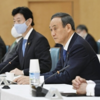 Japan to raise medical fees for people over 75 based on income
