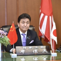 Defense Minister Nobuo Kishi holds a videoconference with Chinese counterpart Wei Fenghe on Monday. | DEFENSE MINISTRY / VIA KYODO