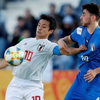 Japan's Mitsuki Saito contends for the ball with Italy's Roberto Alberico during their Under-20 World Cup match on May 29, 2019, in Bydgoszcz, Poland. | REUTERS
