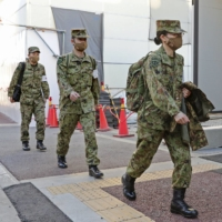 Self-Defense Force nurses arrive at a new facility set up at Osaka General Medical Center for seriously ill COVID-19 patients on Tuesday. | POOL / VIA KYODO