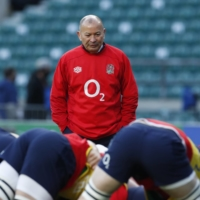 England head coach Eddie Jones watches over warmups before his team's Autumn Nations Cup match against France on Dec. 6 in London. | REUTERS