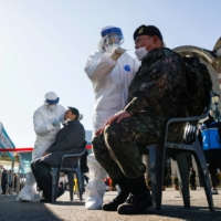 A South Korean soldier undergoes a coronavirus test in Seoul on Tuesday.  | REUTERS