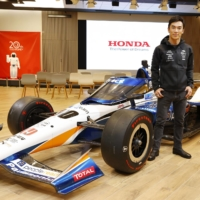 Takuma Sato poses for a photo following an interview in Tokyo on Dec. 7. | KYODO