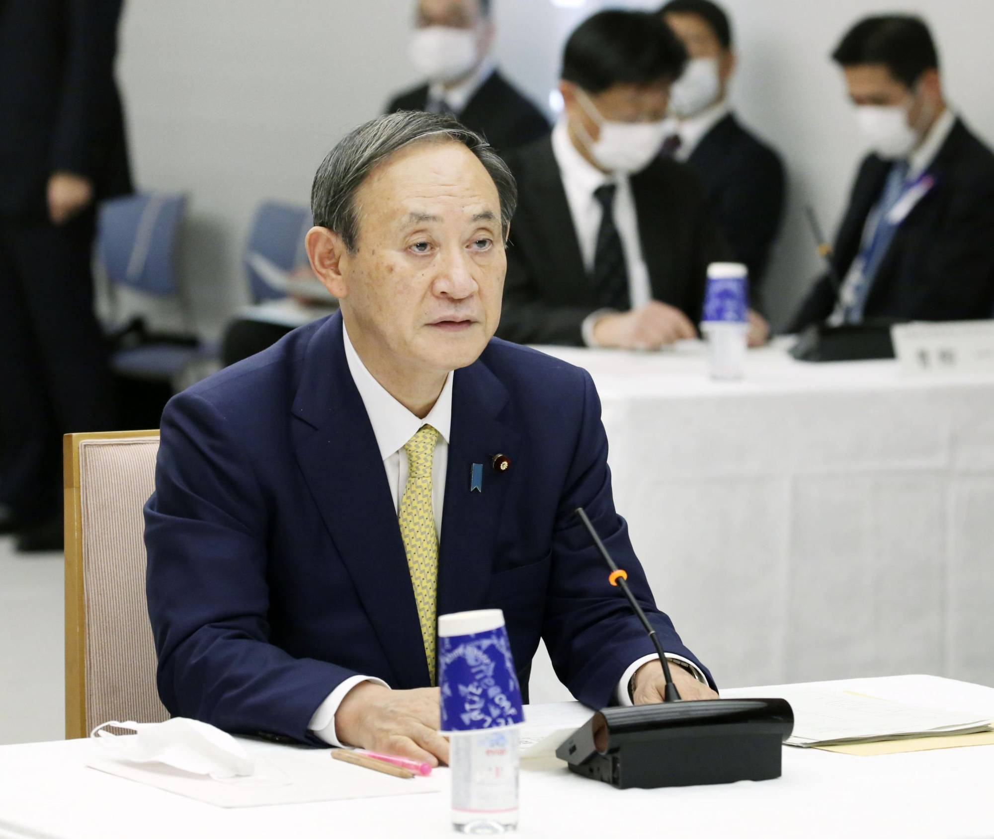 Prime Minister Yoshihide Suga speaks at a meeting in the Prime Minister's Office on Tuesday. He is coming under fire for joining six others in a year-end dinner Monday. | KYODO