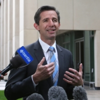 Simon Birmingham, Australia's trade minister, addresses members of the media outside the Parliament House in Canberra in October 2019. | AP