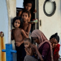 A young Rohingya family arrives in Indonesia.  | AFP-JIJI