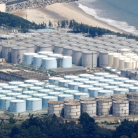 Tanks containing radioactive water are seen at the Fukushima No. 1 nuclear power plant grounds in August. | KYODO