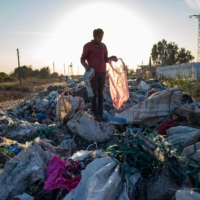 A man collects items from an illegal dump in Adana, southern Turkey. | AFP-JIJI