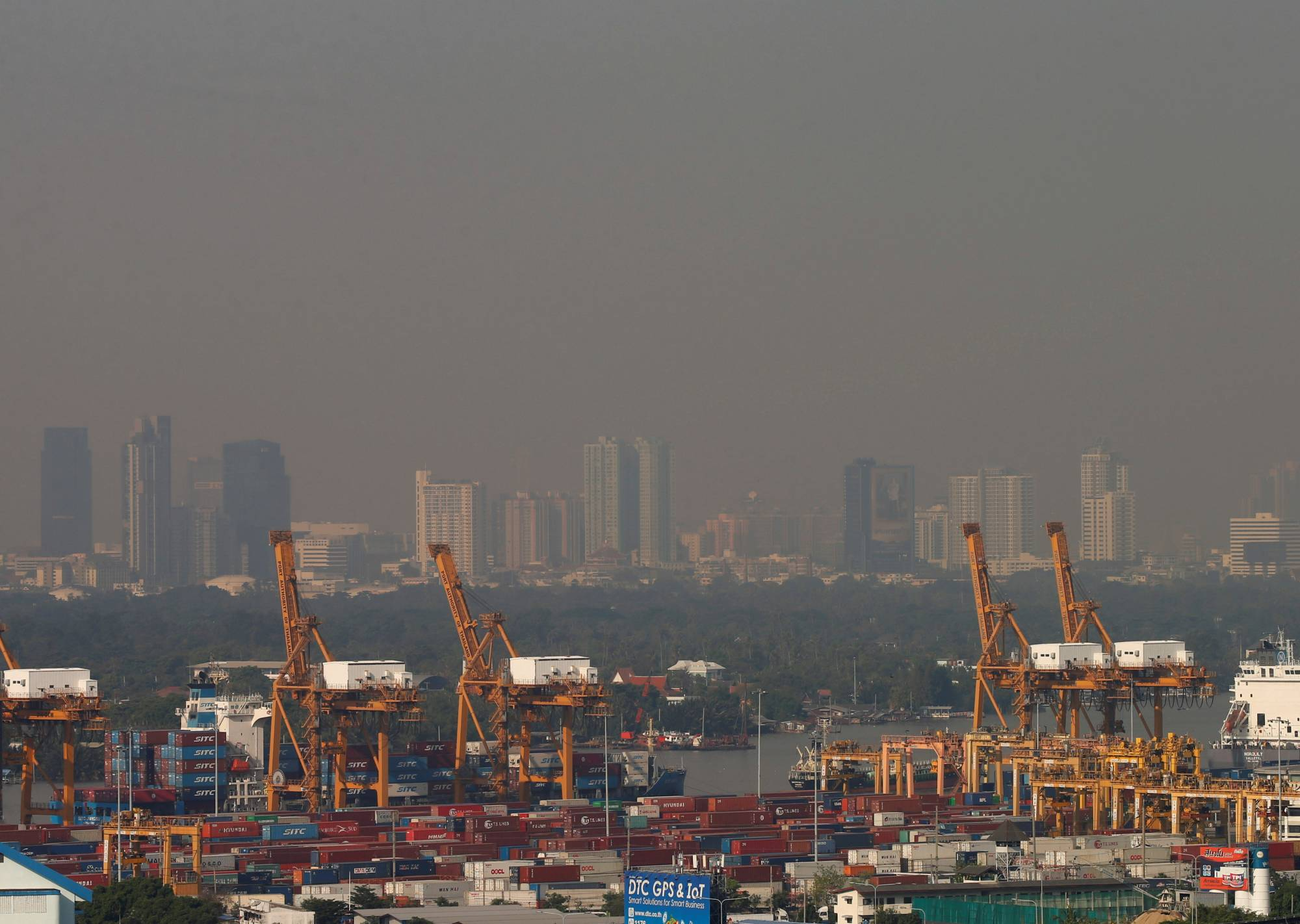 Buildings are shrouded in haze in Bangkok on Wednesday. | REUTERS