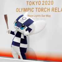Tokyo 2020 Olympic mascot Miraitowa holds the Olympic torch during an event in Tokyo on June 1, 2019. | REUTERS