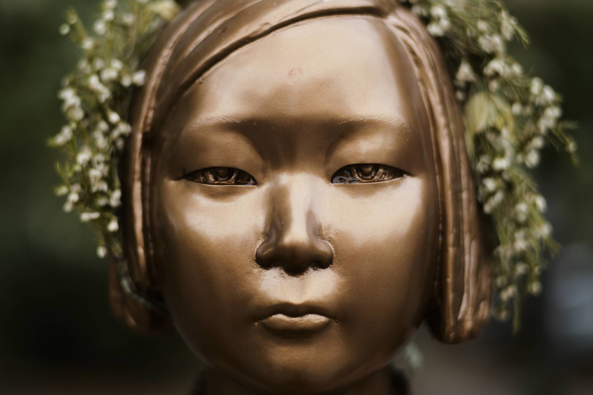 A statue commemorating so-called 'comfort women' is displayed in a residential area in central Berlin. | AP