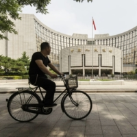 The People's Bank of China headquarters in Beijing | BLOOMBERG