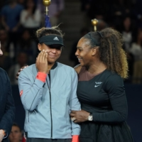 Japan's Naomi Osaka is comforted by Serena Williams of the U.S. after their U.S. Open final, won by Oaska, at Arthur Ashe Stadium in New York in 2018. | CHANG W. LEE / THE NEW YORK TIMES