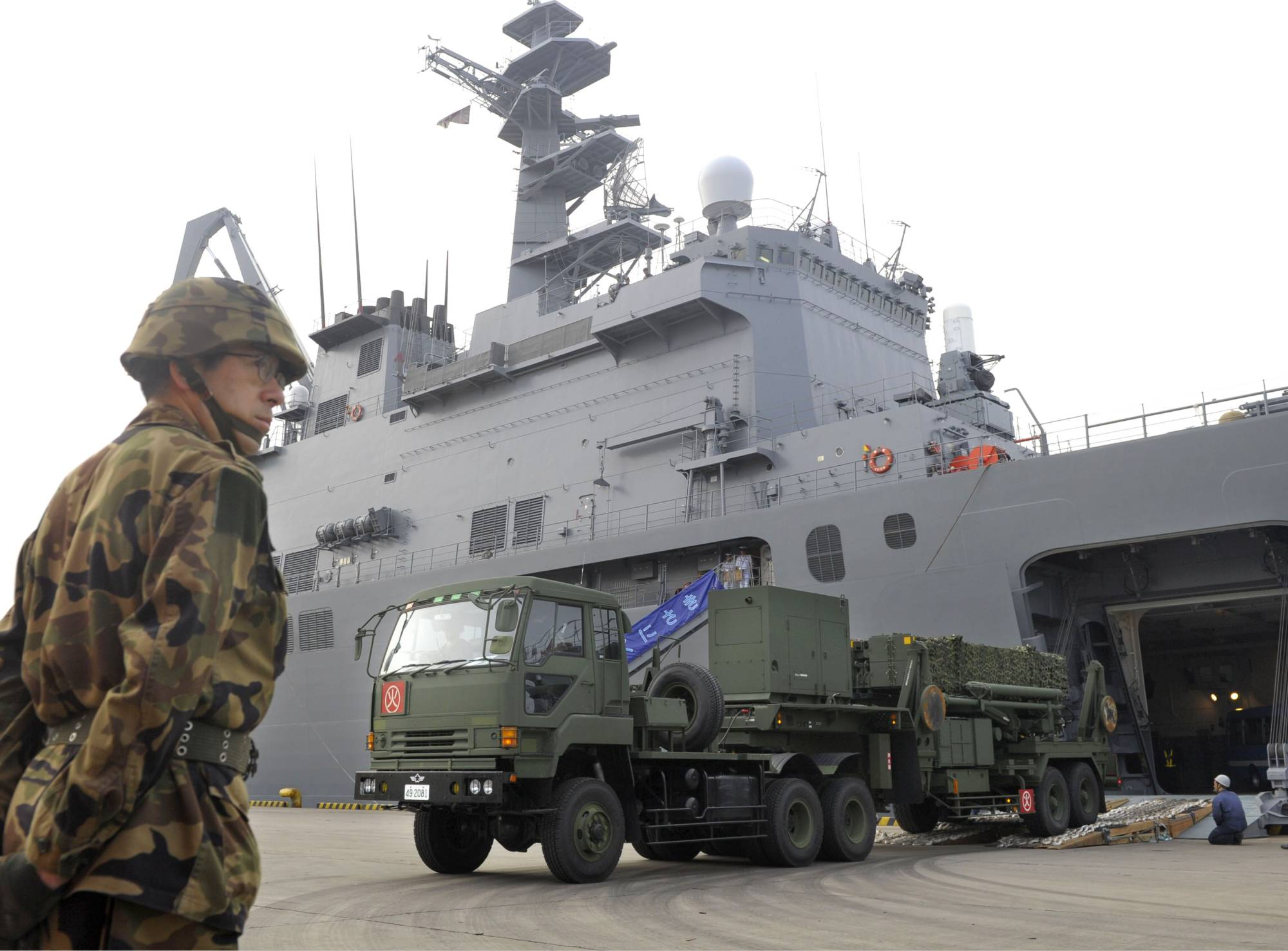 A truck loaded with Patriot Advanced Capability-3 missiles disembarks from a Japan Maritime Self-Defense Force transport ship at Ishigaki port in April 2012. | KYODO