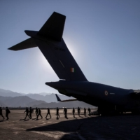 Indian soldiers disembark from a military transport plane at a forward airbase in Leh, in the Ladakh region, on Sept. 15.  | REUTERS