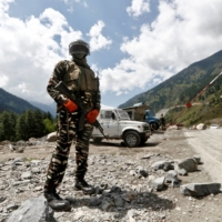An Indian Central Reserve Police Force personnel stands guard at a checkpoint along a highway leading to Ladakh, at Gagangeer in Kashmir's Ganderbal district, om Sept. 2. | REUTERS