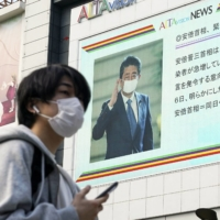 Prime Minister Shinzo Abe declared a state of emergency in large cities such as Tokyo and Osaka in April following a surge in coronavirus infections. | KYODO