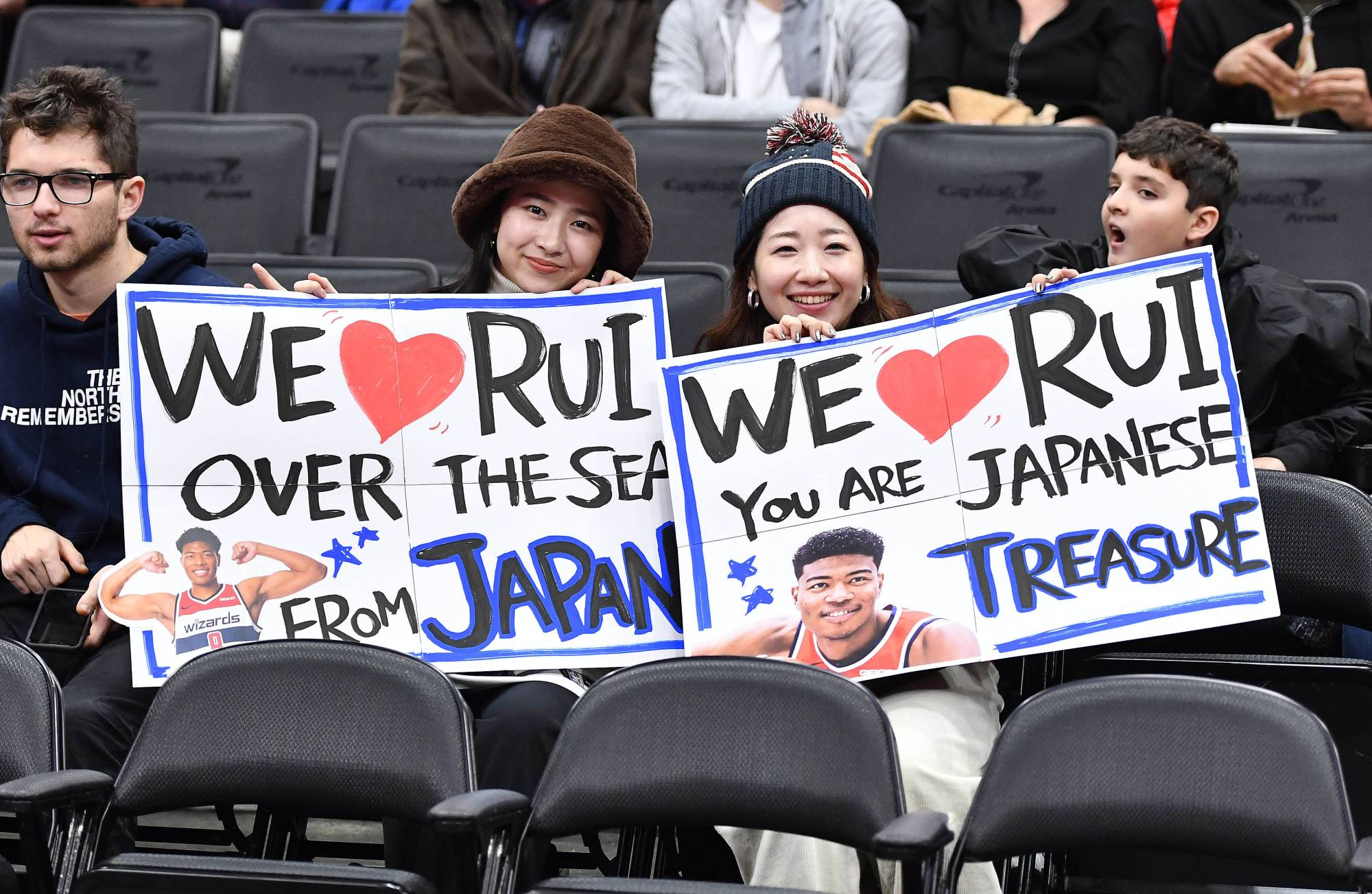 Wizards fans show support for forward Rui Hachimura before a game against the Heat on Dec. 30, 2019, in Washington. | USA TODAY / VIA REUTERS