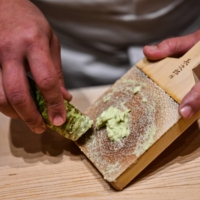 Grated to order: Japanese sushi master Toshiya Matsushita shreds fresh wasabi at his restaurant in Tokyo. | CHARLY TRIBALLEAU / AFP
