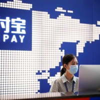 Alipay has offered consumers and small businesses a reliable and speedy service for exchanging goods for money, and is fast taking the place of credits cards and cash. | REUTERS