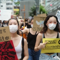 Get the message: The march in Tokyo on June 6 wound through bustling Shibuya Ward. | RYUSEI TAKAHASHI