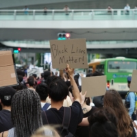 On the march: People took to the streets of Tokyo on June 6 to show solidarity with the Black Lives Matter movement. | RYUSEI TAKAHASHI