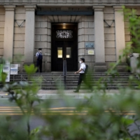 The Bank of Japan decided Friday to extend its program to support corporate funding by six months to the end of September next year as a resurgence of coronavirus cases has raised uncertainty over the economy. | BLOOMBERG