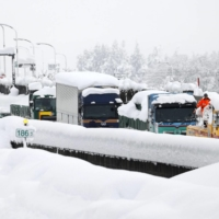 Rescue work continues on Japan highway where 670 cars still stranded in snow