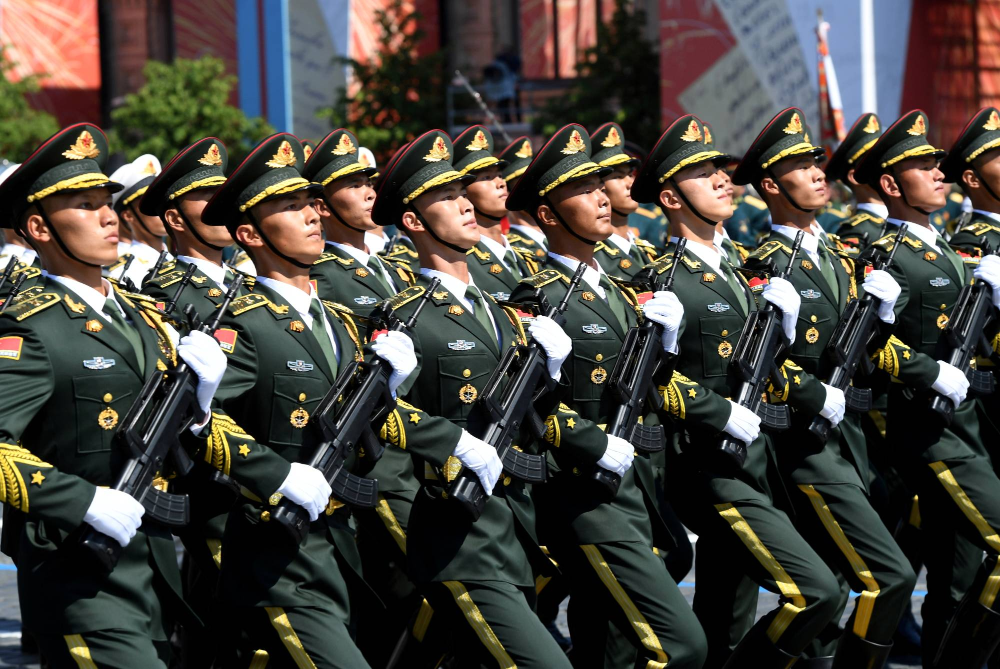 Chinese People's Liberation Army soldiers march during a Parade in Moscow's Red Square in June. | SERGEY PYATAKOV / VIA REUTERS
