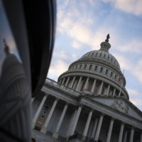 The U.S. Congress on Friday passed and sent to President Donald Trump a two-day stopgap extension of existing federal funds to avoid a midnight government shutdown. | BLOOMBERG